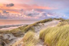 Morze wydmy o zachodzie słońca